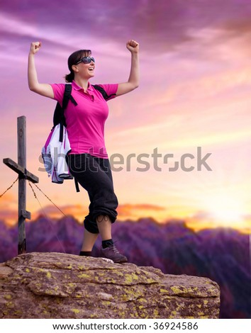 sportive woman on the top of a mountain - stock photo