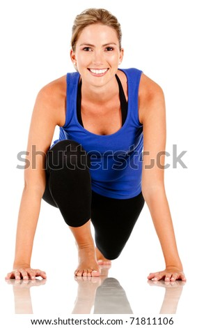 Sportive woman ready to run - isolated over a white background - stock photo