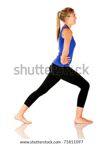 Sportive woman stretching - isolated over a white background - stock photo