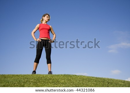 Sportive young woman looking around after exercise - stock photo
