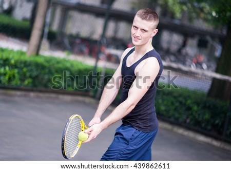 Sportman playing tennis - stock photo