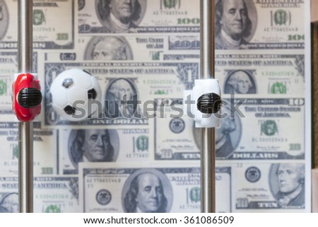 Sports and money. Concept about money spending in football (soccer), sports betting and manipulated fixed matches. Selective focus image - stock photo