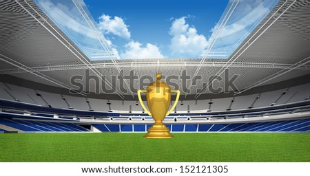 Sports background - Gold trophy on green stadium - stock photo