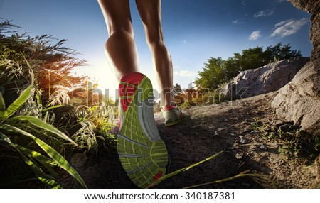 Sports background. Runner feet running on path. Closeup on shoe. - stock photo
