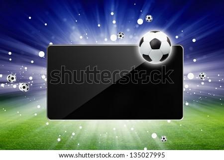 Sports background - soccer ball, tablet computer, bright light, green stadium, soccer live - stock photo