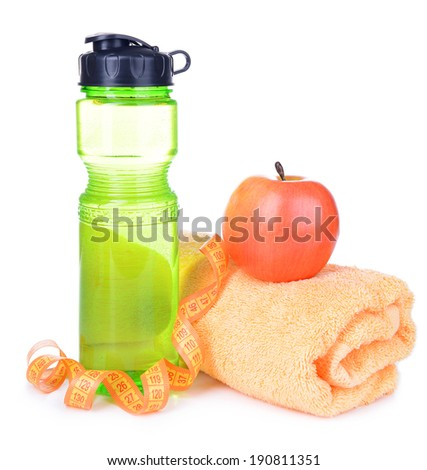 Sports bottle, apple,towel and measuring tape isolated on white - stock photo