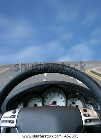 sports car about to take a bend - stock photo