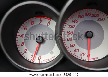Sports Car Dashboard - stock photo