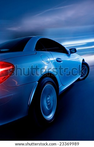 Sports Car in Motion - stock photo