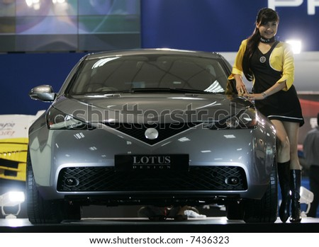 Sports car with a model at a carshow. - stock photo