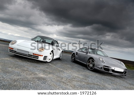 Sports cars under storm clouds
