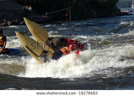 Sports catamaran in a threshold on the rough river - stock photo