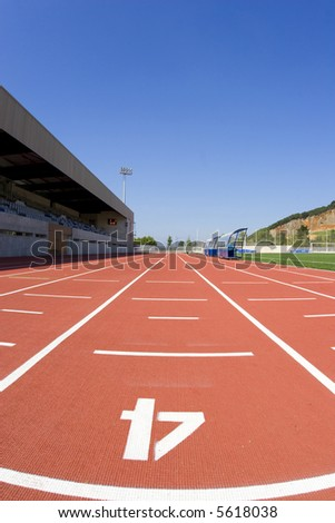 Sports centre with a red racetrack - stock photo