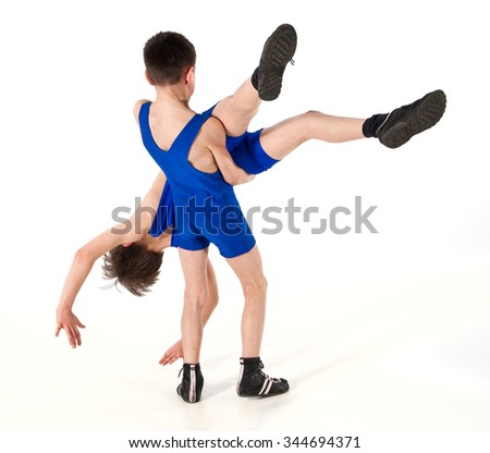 Sports competition of young wrestlers.Figures on a white background.Athletes in training fighters.Young fighters carried out a sports reception..Freestyle fight.Victory.