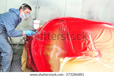 Sports coupe painting red by professional. - stock photo