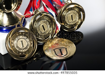 Sports Cup and medal on a black white background