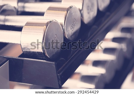 Sports dumbbells  ( Filtered image processed vintage effect. ) - stock photo