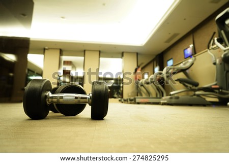 Sports dumbbells in modern sports club. Weight Training equipment.  - stock photo