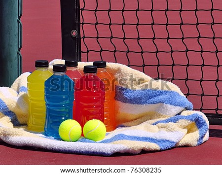 Sports Energy Drinks And Towel On Tennis Court