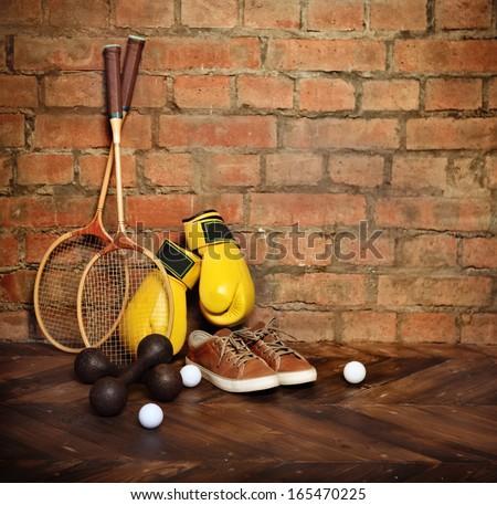 Sports equipment near the brick wall.Retro style - stock photo