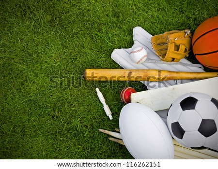 sports equipment on grass, football, rugby, baseball, cricket, basketball - stock photo