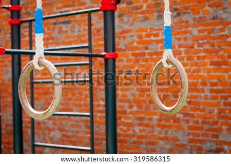 Sports equipment outdoor playground rings - stock photo