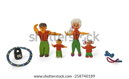 Sports family. Children clay crafts. - stock photo