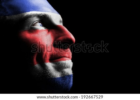 Sports fan from Costa Rica. Isolated on black. - stock photo