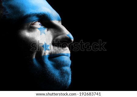 Sports fan from Honduras. Isolated on black. - stock photo