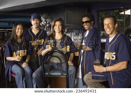Sports Fans in Bar - stock photo