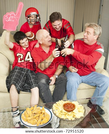 Sports fans toasting the win of their favorite football team. - stock photo
