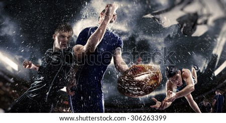 Sports, game, fighting - Rugby players on a stadium in the rain - stock photo