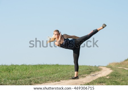 Sports girl doing exercises