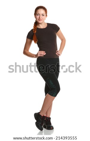 sports girl with an athletic body is engaged in fitness. good health, active movement