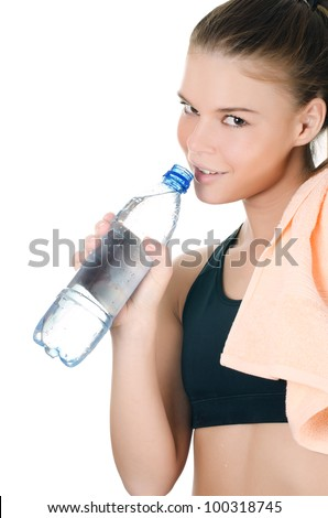 Sports girl with towel and water bottle