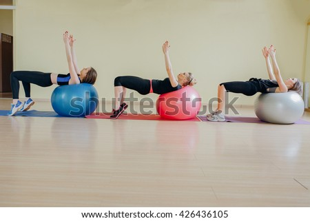 Sports girls spend a morning aerobics with inflatable balls for aerobics