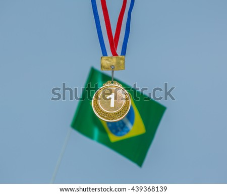 sports gold medal and a Brazilian flag