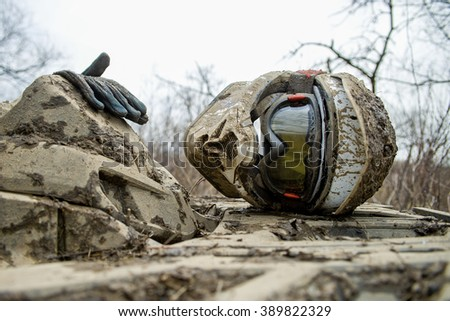 sports helmet and gloves for Enduro lie on a Quad bike , all covered in mud. Enduro - stock photo