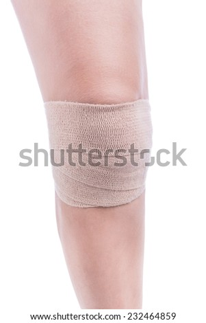 Sports injuries of the knee. Bandage elastic tied. - stock photo