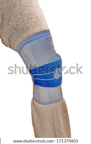 Sports knee brace - a stabilizing silicone blue and gray medical sports knee brace worn over sweatpants