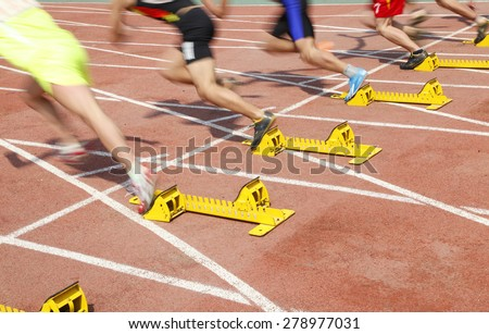 Sports meeting, the athlete sprint start - stock photo