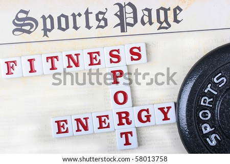 Sports page with a crossword puzzle combined from words fitness, sports and energy.