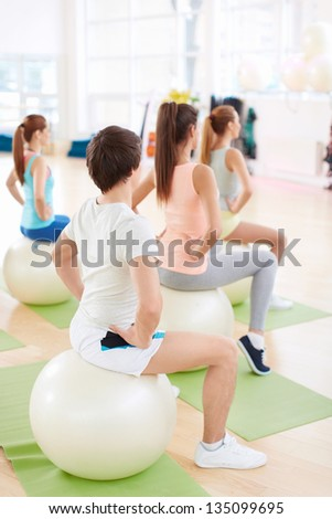 Sports people with balls indoors - stock photo