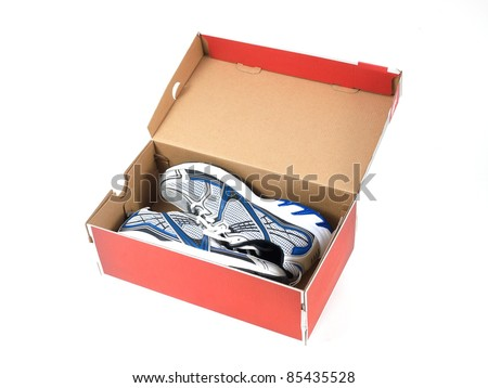 Sports runners situated in a shoe box - stock photo