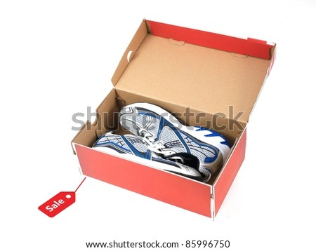 Sports runners situated in a shoe box