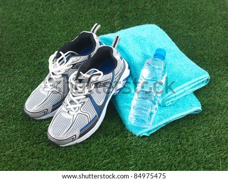 Sports runners situated on artificial turf - stock photo