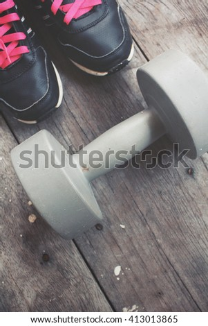 Sports set of sneakers with dumbbells