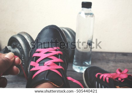 Sports set of water drink sneakers with dumbbell