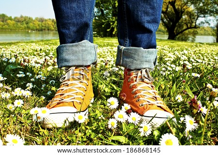 Sports Shoes and grass - stock photo