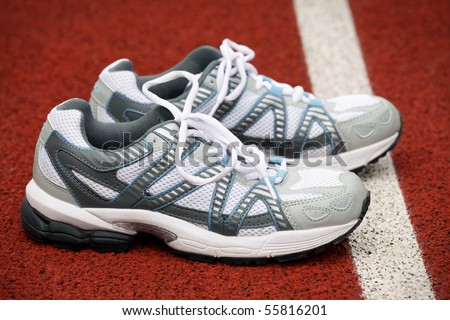 Sports shoes for tennis on court background - stock photo